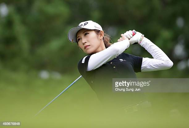 Kumiko Kaneda of Japan plays a tee shot on the 9th hole during the first round of the Nobuta Group Masters GC Ladies at the Masters Gold Club on...