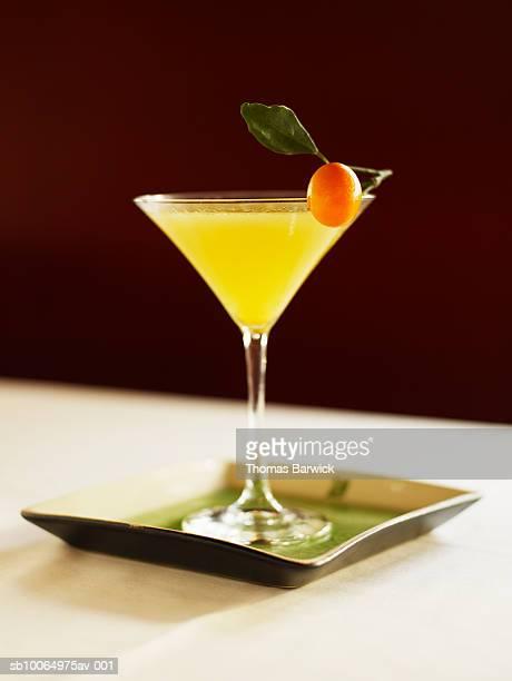 Kumquat crush martini with gin, close-up