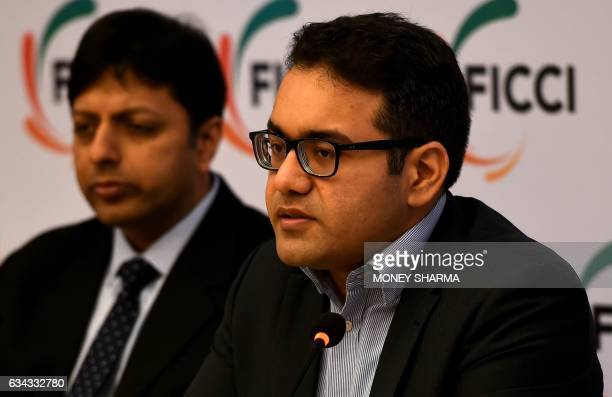 Kunal Bahl Cofounder and CEO Snapdeal is watched by Amit Agarwal Country Head Amazon India as he speaks during a press conference on Model GST Law...