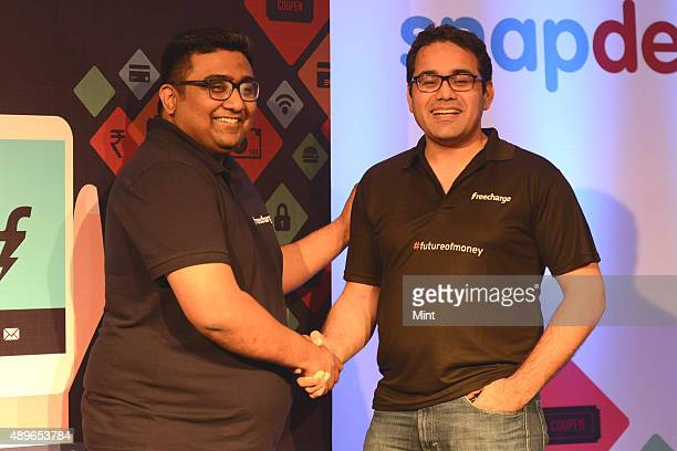 Kunal Shah Founder CEO of FreeCharge and Kunal Bahl CoFounder and CEO of Snapdeal during the launch of Mobile Payments Wallet on September 15 2013 in...