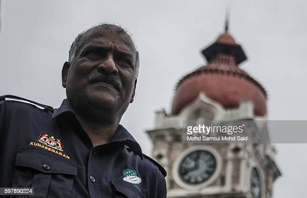 V Kunasegaran 60 pose for photographer in front the Sultan Abdul Samad building's 118yearold clock tower at Independent square on August 30 2016 in...