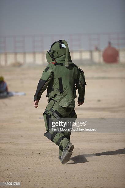 Kunduz, Afghanistan - A U.S. Marine tries running in a German Army EOD blast suit.