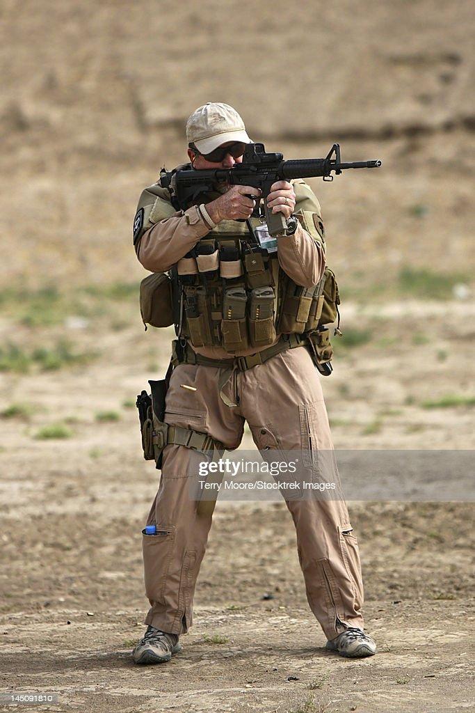 Kunduz, Afghanistan - U.S. Contractor firing a 5.56mm M4 Carbine.