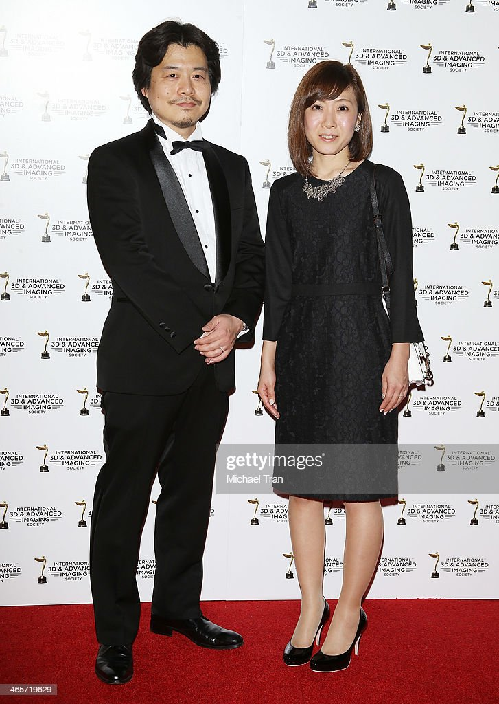 Kunihiko Mita (L) and guest arrive at the 2014 International 3D and Advanced Imaging Society's Creative Arts Awards held at Steven J. Ross Theatre on January 28, 2014 in Burbank, California.