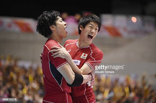 Kunihiro Shimizu and Yuki Ishikawa of Japan celebrate after winning a point against Russia during the FIVB Men's Volleyball World Cup Japan 2015 at...