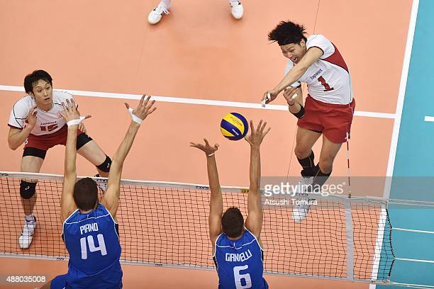 Kunihiro Shimizu of Japan spikes in the match between Italy and Japan during the FIVB Men's Volleyball World Cup Japan 2015 at the Hiroshima Green...