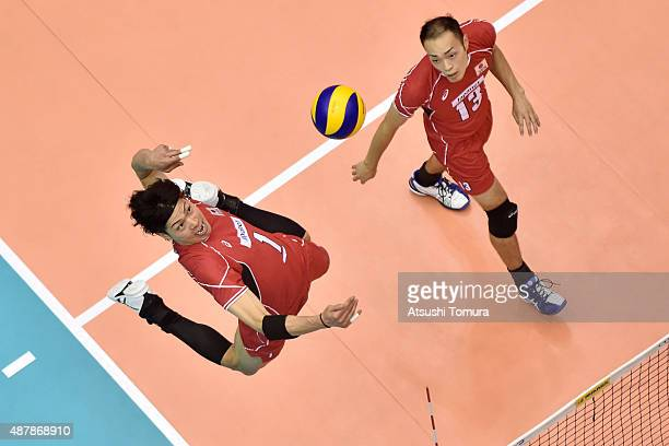 Kunihiro Shimizu of Japan spikes in the match between Japan and Canada during the FIVB Men's Volleyball World Cup Japan 2015 at the Hiroshima Green...