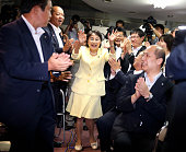 Kuniko Inoguchi of the Liberal Democratic Party celebrates winning a seat in the Upper House election at her election campaign headquarters on July...