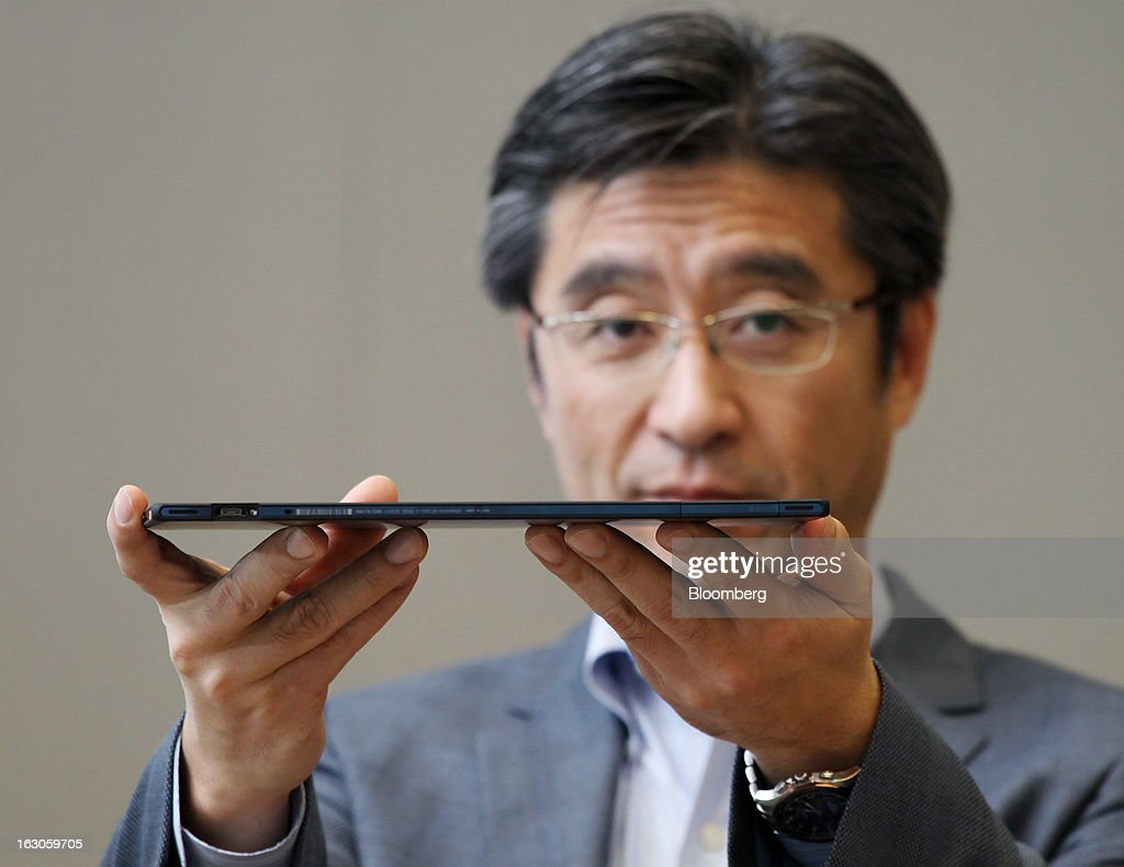 Kunimasa Suzuki, president and chief executive officer of Sony Mobile Communications, holds a Sony Corp. Xperia Tablet Z during an interview in Tokyo, Japan, on Monday, March 4, 2013. Sony plans to make its mobile-device business profitable next fiscal year as it boosts shipments of smartphones, Suzuki said. Photographer: Junko Kimura/Bloomberg via Getty Images