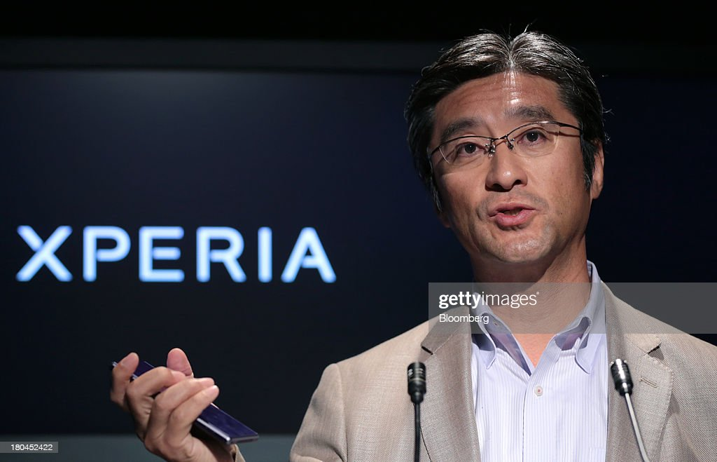 Kunimasa Suzuki, president and chief executive officer of Sony Mobile Communications, holds a Sony Corp. Xperia Z1 smartphone as he speaks during a news conference in Tokyo, Japan, on Friday, Sept. 13, 2013. Sony Corp. is betting its Xperia Z1 handset will propel it to No. 3 in the smartphone market, leaping from seventh place by vaulting past competitors such as LG Electronics Inc. and Lenovo Group Ltd. Photographer: Yuriko Nakao/Bloomberg via Getty Images