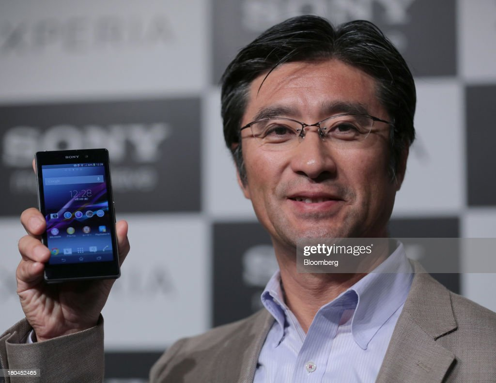 Kunimasa Suzuki, president and chief executive officer of Sony Mobile Communications, holds up a Sony Corp. Xperia Z1 smartphone during a news conference in Tokyo, Japan, on Friday, Sept. 13, 2013. Sony Corp. is betting its Xperia Z1 handset will propel it to No. 3 in the smartphone market, leaping from seventh place by vaulting past competitors such as LG Electronics Inc. and Lenovo Group Ltd. Photographer: Yuriko Nakao/Bloomberg via Getty Images
