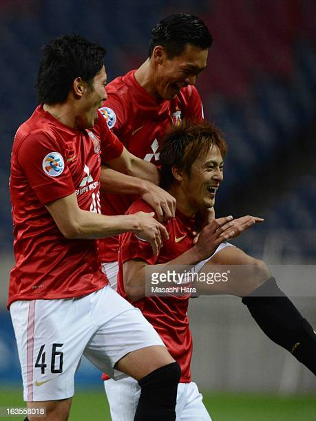 Kunimitsu Sekiguchi of Urawa Red Diamonds celebrates with his teammates after scoring the second goal during the AFC Champions League Group F match...