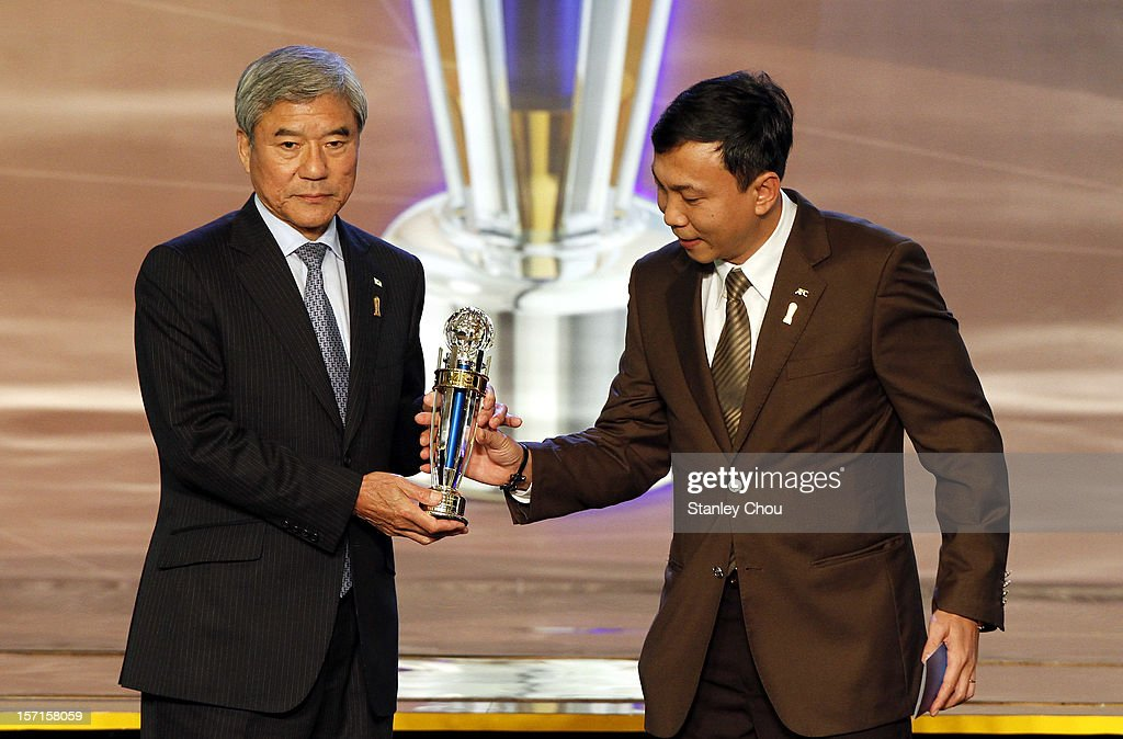 Kuniya Daini (L), President of Japan Football Association, receives The 2012 AFC Futsal Team of The Year Award from Dr. Tran Quoc Tuan, AFC Exco Member, during The 2012 AFC Annual Awards at the Mandarin Oriental Hotel on November 29, 2012 in Kuala Lumpur, Malaysia.