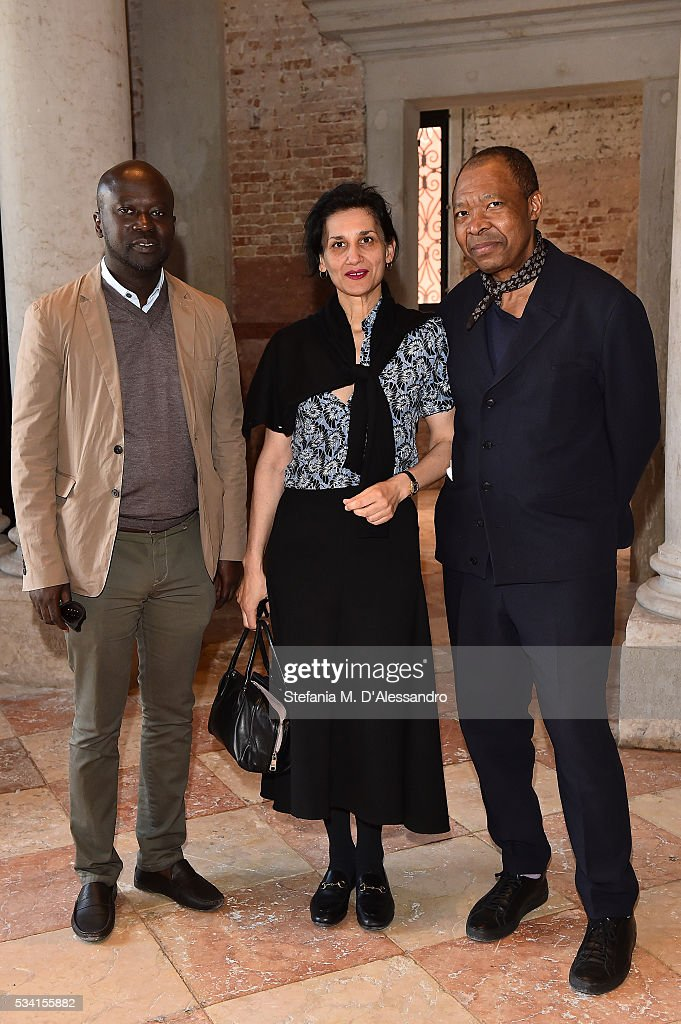 Kunle Adeyemi, Louise Neri and Okwui Enwezor attend the private view and lunch of 'Belligerent Eyes' at Fondazione Prada at Ca' Corner della Regina on May 25, 2016 in Venice, Italy.