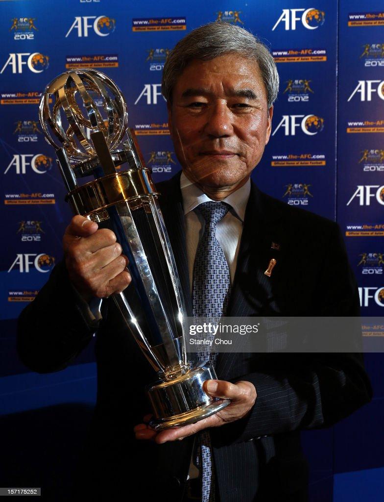 Kunlya Daini President of Japan Football Association shows off the prestigious accolade award of the 2012 AFC Asian International Player of the Year Award on behalf of Shinji Kagawa of Japan during the 2012 AFC Annual Awards at the Mandarin Oriental Hotel on November 29, 2012 in Kuala Lumpur, Malaysia.