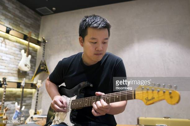 Kuok Meng Ru founder of Bandlab Technologies Ltd plays guitar during an interview in Singapore on Wednesday Nov 22 2017 Kuok said he wants to buy the...