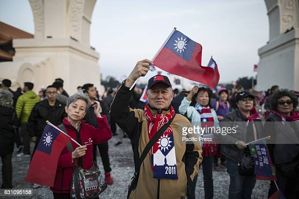 Kuomintang' supporters holding flag in the election campaign General elections were held in Taiwan on 16 January 2016 in order to elect the 14th...