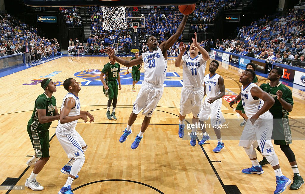 Kuran Iverson #23 of the Memphis Tigers grabs a rebound against the USF Bulls on January 26, 2014 at FedExForum in Memphis, Tennessee. Memphis beat South Florida 80-58.