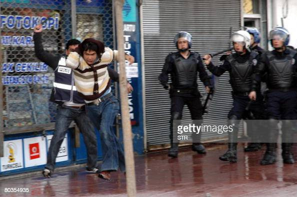 A Kurdish boy runs away during a clash with riot police in Van on March 24 2008 Unrest in the Kurdish region of southeast Turkey on Sunday left two...