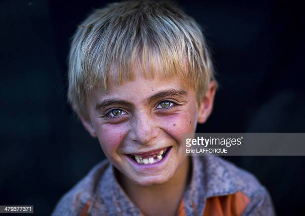 Kurdish boy with blue and green eyes in Palangan Iran on September 13 2013