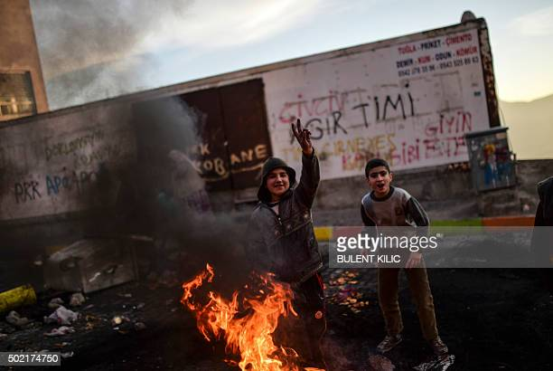 Kurdish boys stand behind barricades during a demonstration against security operations against Kurdish rebels in the southeastern Turkish cities...