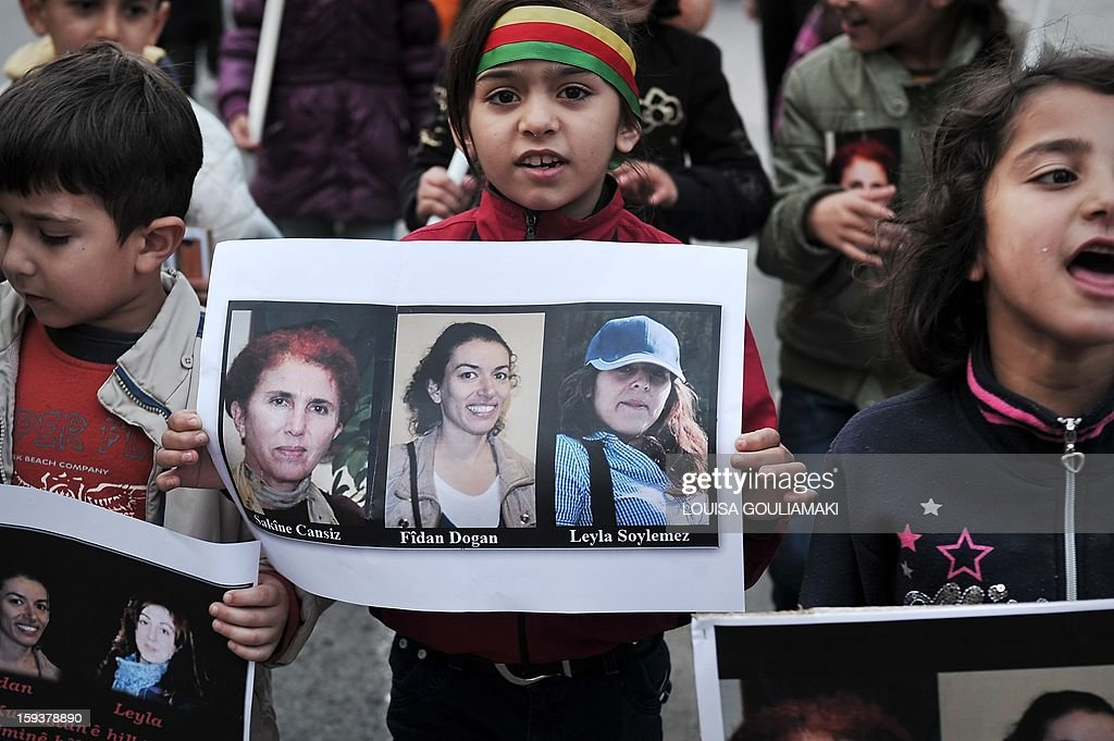 Kurdish children hold pictures of the three Kurdish activits found shot dead at the Kurdistan Information Bureau in Paris, during a protest in Athens by Kurds living in Greece on January 12, 2013. Kurdish activists have accused Turkey or rogue nationalist elements in the country's military of being behind the killings.
