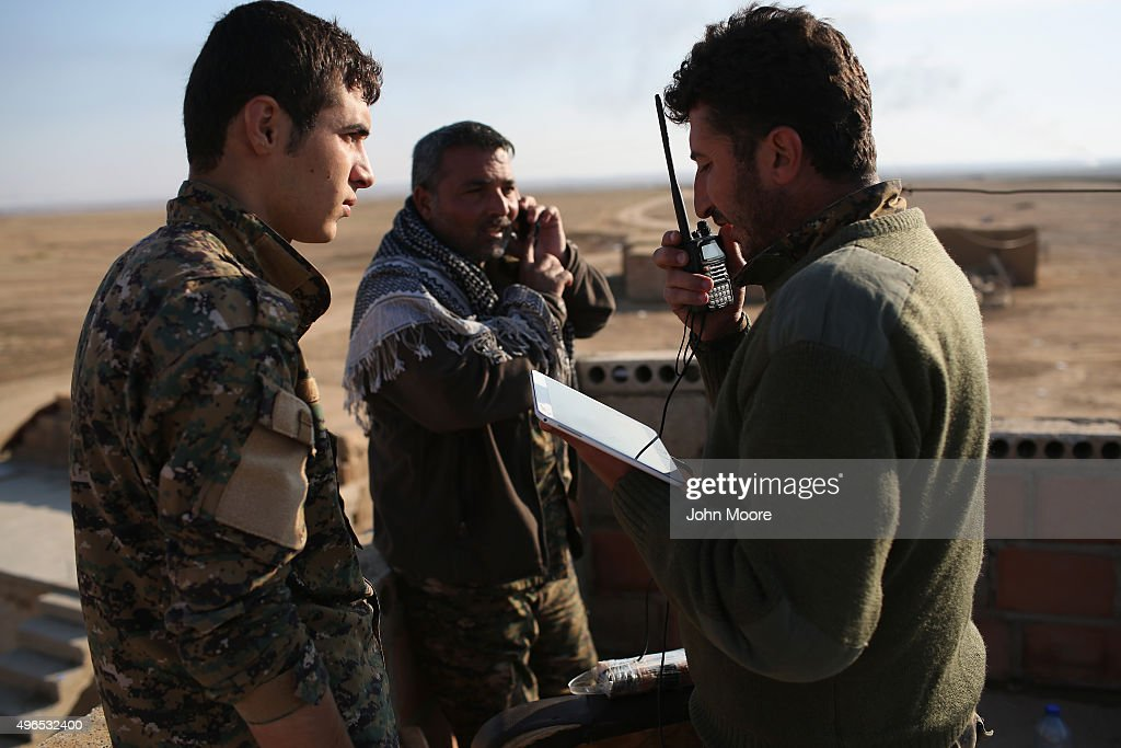 Kurdish commanders from the Syrian Democratic Forces coordinate frontline troop movements with the help of a tablet on November 10, 2015 near the ISIL-held town of Hole in the autonomous region of Rojava, Syria. The forces, primarily Kurdish, are attacking ISIL extremists in the area near the Iraqi border and calling in airstrikes from U.S.-led coaltion warplanes. The autonomous region of Rojava in northern Syria has become a bulwark against the Islamic State. The Rojava armed forces, with the aid of U.S. airstrikes and weapons, are retaking territory which had earlier been captured much by ISIL from the Syrian regime.