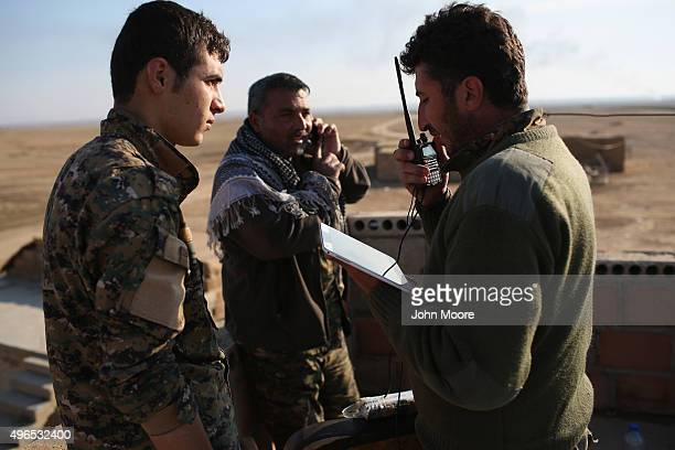 Kurdish commanders from the Syrian Democratic Forces coordinate frontline troop movements with the help of a tablet on November 10 2015 near the...