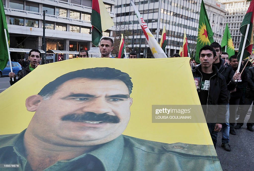 Kurdish demonstrators hold a banner depicting the jailed Kurdish rebel leader Abdullah Ocalan, during a protest in Athens by Kurds living in Greece on January 12, 2013. Kurdish activists have accused Turkey or rogue nationalist elements in the country's military of being behind the killings. AFP PHOTO / LOUISA GOULIAMAKI