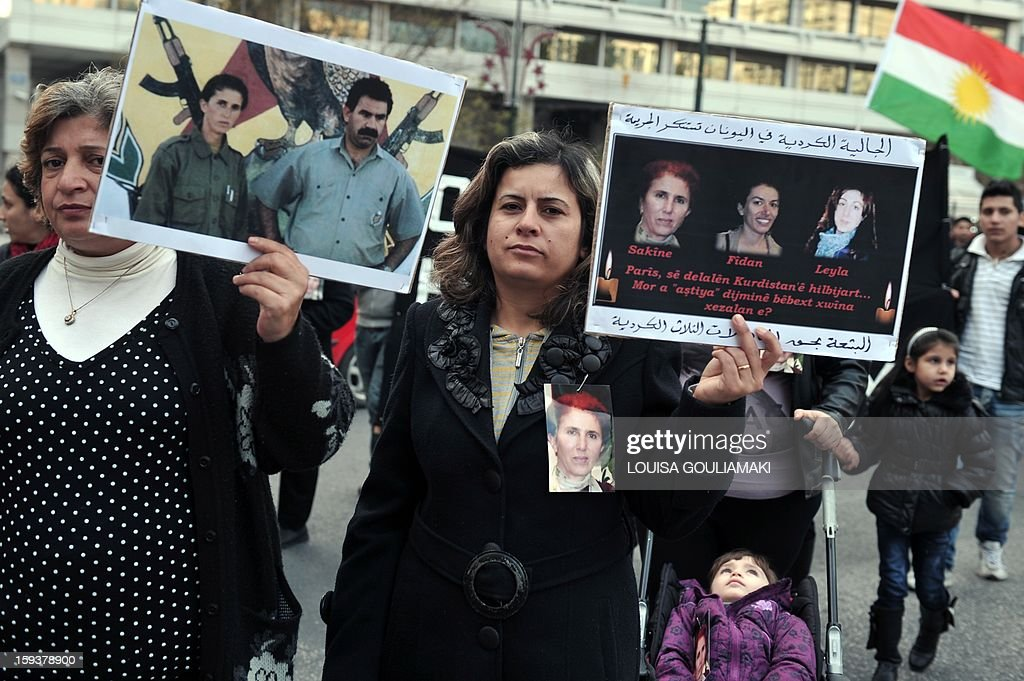 Kurdish demonstrators hold pictures of the three Kurdish activits found shot dead at the Kurdistan Information Bureau in Paris and a picture of jailed Kurdish rebel leader Abdullah Ocalan, during a protest in Athens by Kurds living in Greece on January 12, 2013. Kurdish activists have accused Turkey or rogue nationalist elements in the country's military of being behind the killings.