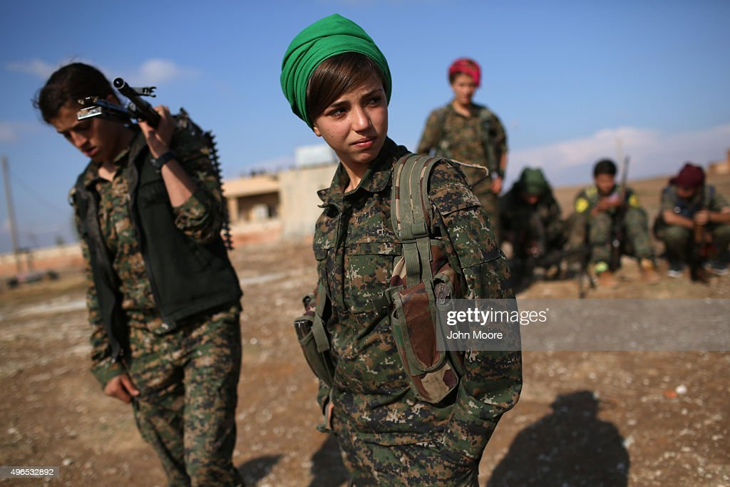 Kurdish female troops from the Syrian Democratic Forces stand in a forward operating base overlooking the frontline on November 10, 2015 near the ISIL-held town of Hole in the autonomous region of Rojava, Syria. The forces, primarily Kurdish, are attacking ISIL extremists in the area near the Iraqi border and calling in airstrikes from U.S.-led coalition warplanes. The autonomous region of Rojava in northern Syria has become a bulwark against the Islamic State. The Rojava armed forces, with the aid of U.S. airstrikes and weapons, are retaking territory which had earlier been captured much by ISIL from the Syrian regime.