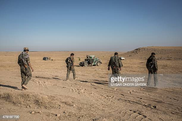 Kurdish fighters are pictured during a clashes with fighters from the Islamic State group on the outskirts of Syrian city of Hasakeh on June 29 2015...
