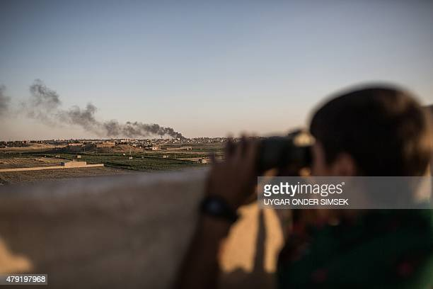 Kurdish fighters are pictured during a clashes with fighters from the Islamic State group on the outskirts of Syrian city of Hasekeh on June 30 2015...