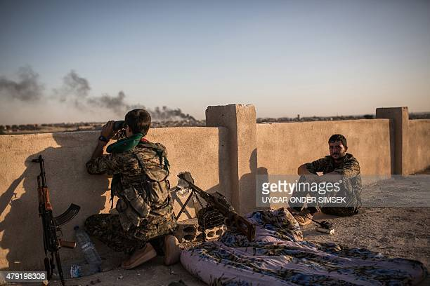 Kurdish fighters are pictured during clashes with fighters from the Islamic State group on the outskirts of Syrian city of Hasakeh on June 30 2015...