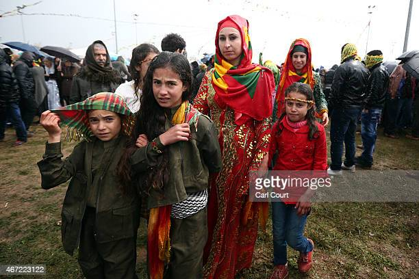 Kurdish girls in Peshmerga uniforms and traditional outfits take part in Kurdish New Year celebrations on March 21 2015 in Diyarbakir Turkey...