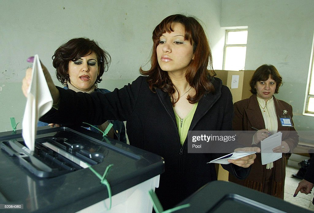 Kurdish Iraqi woman casts her vote at a polling station January 30 2005 in the northern Kurdish city of Suleimaniya Iraq Iraqi Kurds flocked to...