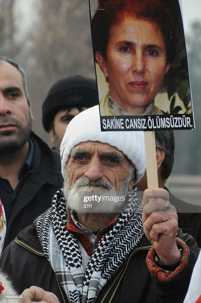 A Kurdish man holds the portrait of the slain member of the Kurdistan Workers' Party (PKK), Sakine Cansiz, during a protest in Diyarbakir against the killings of the three Kurdish women activists, in Diyarbakir, on January 13, 2013. Turkish Prime Minister Recep Tayyip Erdogan called on France on January 12 to 'immediately' clarify the killing of three Kurdish activists who were shot dead in Paris, while asking French President Francois Hollande to explain why he was meeting with members of the outlawed PKK. AFP PHOTO / STRINGER