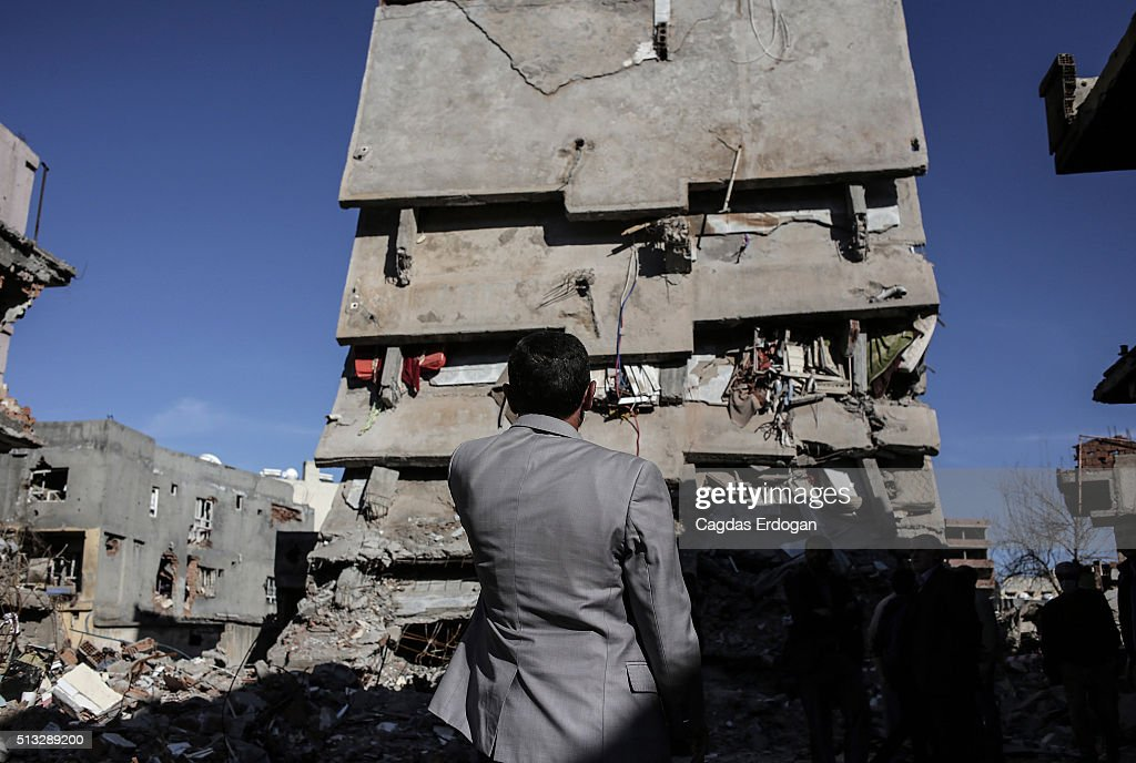Kurdish man looks the ruined houses and shops in Cizre March 2 Turkey Turkish authorities scaled down a 24hour curfew imposed on the mainly Kurdish...