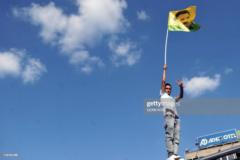 A kurdish man waves a flag picture of PKK (Kurdistan Workers Party) jailed leader Abdullah Ocalan during a peace demonstration at Kadikoy, in Istanbul, on September 1, 2013. Many BDP (Peace and Democracy Party) supporters gathered in the district located on the Anatolian side of Istanbul to mark the Sepember 1 peace day. Turkish police blocked on September 1, 2013 the entrance to Istanbul's Gezi Park, the epicentre of anti-government protests in June, to prevent a demonstration there against a possible military intervention in Syria.