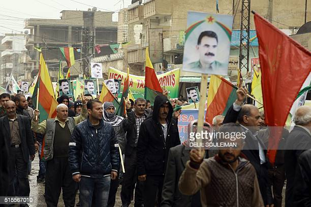 Kurdish men chant slogans on March 14 as thye carry portraits of jailed Kurdish rebel chief Abdullah Ocalan during a demonstration in the...
