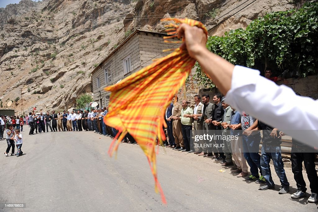 Kurdish men dance during a wedding ceremony at Yekmal village in the mountains of Hakkari on June 24, 2012. Hakkari is a province situated in the Eastern Anatolia region of Turkey, located at the juncture of Iraq and Iran. Mounts Cilo and Sat are the two towering ranges that dominate the topography. The population of Hakkari is mainly Kurdish. Winters are cold and harsh, and summers are hot and dry. Because of the extreme geographic conditions of the region, agriculture as a means of livelihood is limited, and livestock raising is the main activity. The province is historically famous as the birthplace of the renowned 17th century Kurdish poet Ahmad Khani.