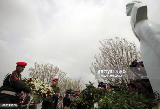 Kurdish pashmerga soldiers lay a wreath at a monumnet commemorating the victims of the 1988 gas attacks in the Iraqi northern Kurdish town of Halabja...