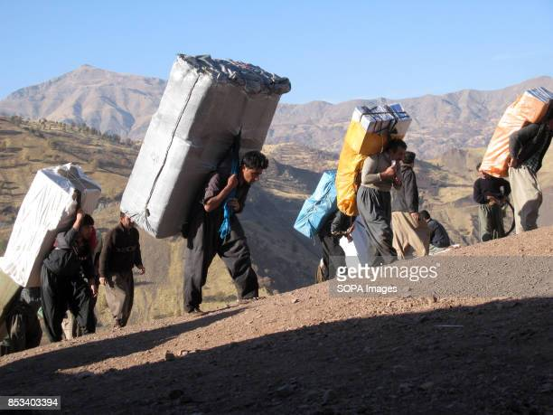 Kurdish people are walking up to the harsh Irani border to transport the goods to final destination For decades the IraqIran border has served as a...