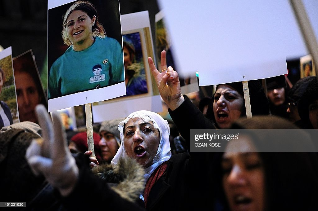 Kurdish people hold pictures of killed three kurdish activists and shout slogans during a demonstration on January 9, 2015 at Istiklal avenue in Istanbul to commemorate the killing of the three top Kurdish activists <a gi-track='captionPersonalityLinkClicked' href=/galleries/search?phrase=Sakine+Cansiz&family=editorial&specificpeople=10112049 ng-click='$event.stopPropagation()'>Sakine Cansiz</a>, Fidan Dogan and Leyla Soylemez. The three women were shot to death on January 9, 2013 at the Kurdish Information Centre in Paris. The motives of the triple killing remain unclear. Banner reads: '365 days later, we are still waiting for the truth. Find those responsible'.
