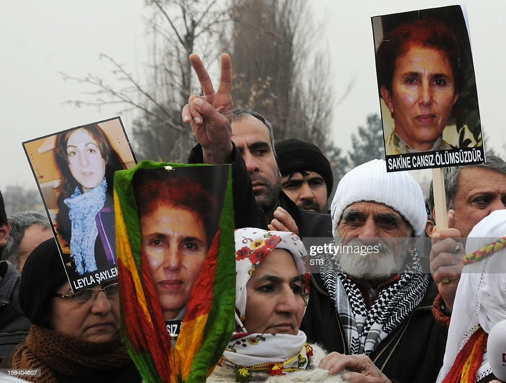 Kurdish people hold portraits of the slain members of the Kurdistan Workers' Party (PKK), Sakine Cansiz (R) and Leyla Soylemez (L) during a protest in Diyarbakir against the killings of the three Kurdish women activists, in Diyarbakir, on January 13, 2013. Turkish Prime Minister Recep Tayyip Erdogan called on France on January 12 to 'immediately' clarify the killing of three Kurdish activists who were shot dead in Paris, while asking French President Francois Hollande to explain why he was meeting with members of the outlawed PKK. AFP PHOTO / STRINGER