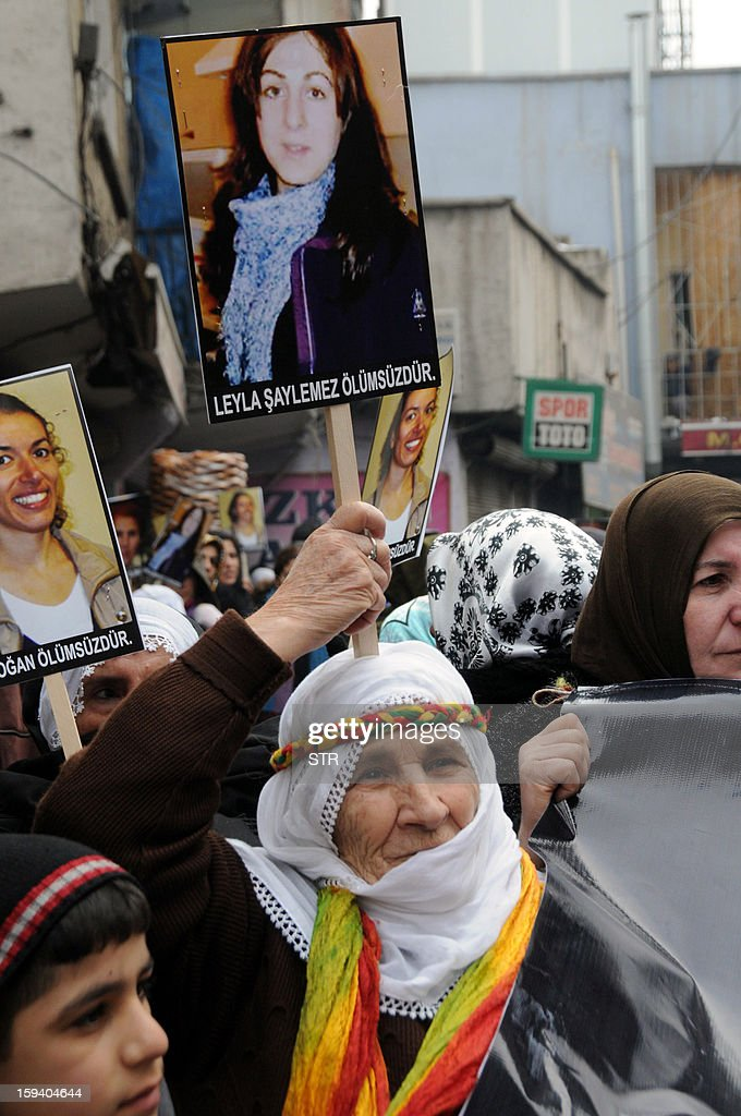 Kurdish people hold portraits of the slain members of the Kurdistan Workers' Party (PKK), Leyla Soylemez (C) and Fidan Dogan (L) during a protest in Diyarbakir against the killings of the three Kurdish women activists, in Diyarbakir, on January 13, 2013. Turkish Prime Minister Recep Tayyip Erdogan called on France on January 12 to 'immediately' clarify the killing of three Kurdish activists who were shot dead in Paris, while asking French President Francois Hollande to explain why he was meeting with members of the outlawed PKK.