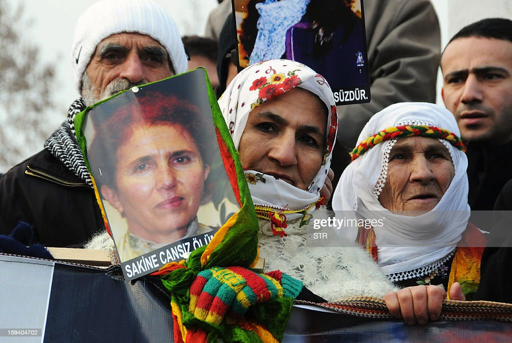 Kurdish people hold portraits of the slain members of the Kurdistan Workers' Party (PKK), Sakine Cansiz (L) and Leyla Soylemez (Top) during a protest in Diyarbakir against the killings of the three Kurdish women activists, in Diyarbakir, on January 13, 2013. Turkish Prime Minister Recep Tayyip Erdogan called on France on January 12 to 'immediately' clarify the killing of three Kurdish activists who were shot dead in Paris, while asking French President Francois Hollande to explain why he was meeting with members of the outlawed PKK. AFP PHOTO / STRINGER