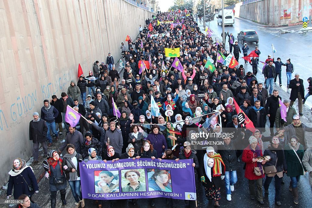 Kurdish people take part in a demonstration on January 9, 2015 in Diyarbakir to commemorate the killing of the three top Kurdish activists <a gi-track='captionPersonalityLinkClicked' href=/galleries/search?phrase=Sakine+Cansiz&family=editorial&specificpeople=10112049 ng-click='$event.stopPropagation()'>Sakine Cansiz</a>, Fidan Dogan and Leyla Soylemez. The three women were shot to death on January 9, 2013 at the Kurdish Information Centre in Paris. The motives of the triple killing remain unclear. Banner reads: '365 days later, we are still waiting for the truth. Find those responsible!'.