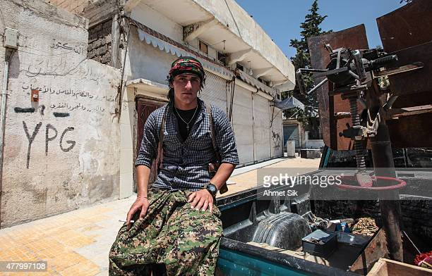 A Kurdish People's Protection Units or YPG fighters controls downtown of Tal Abyad Syria June 19 2015 Kurdish fighters with the YPG took full control...