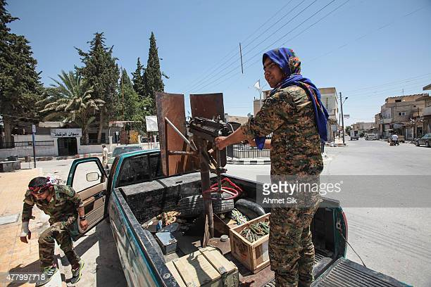 Kurdish People's Protection Units or YPG fighters controls downtown of Tal Abyad Syria June 19 2015 Kurdish fighters with the YPG took full control...